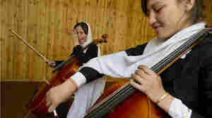 Two 14-year-old Afghan girls practice the cello at the Afghanistan National Institute of Music in Kabul.