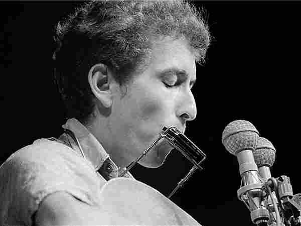 Bob Dylan on stage in, Newport R.I.; credit: Rowland Scherman.