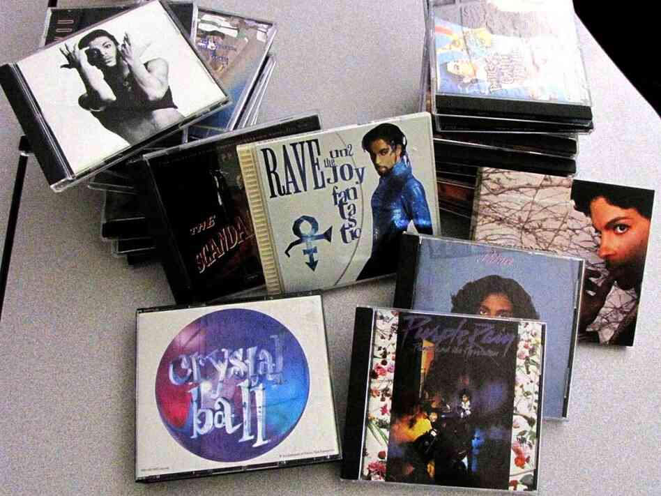 stacks of Prince CDs