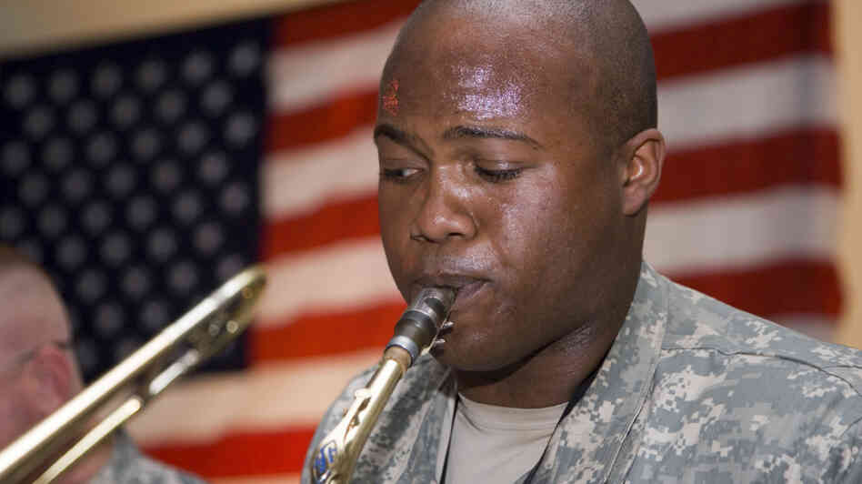 A U.S. soldier plays the saxophone
