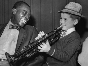 Louis Armstrong and a young fan.