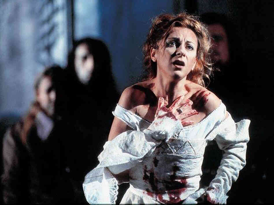 Soprano Natalie Dessay -- with the blood to prove it -- as the unhinged Lucia di Lammermoor.