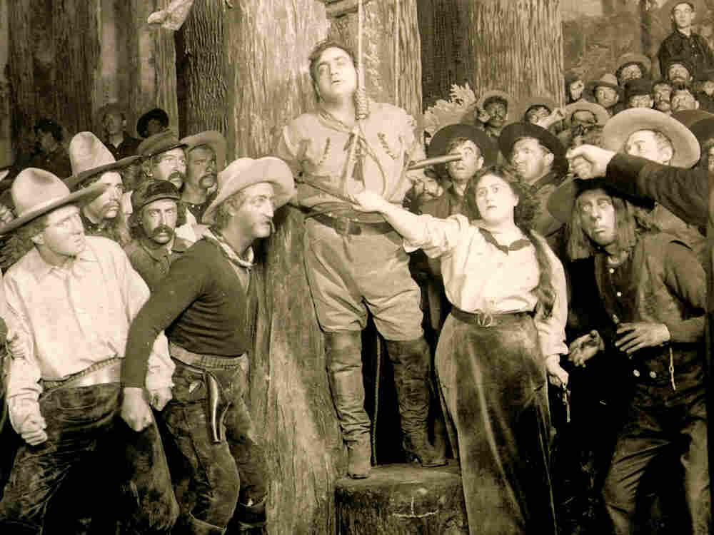 """Enrico Caruso (center) stars in Puccini's """"La Fanciulla del West"""""""