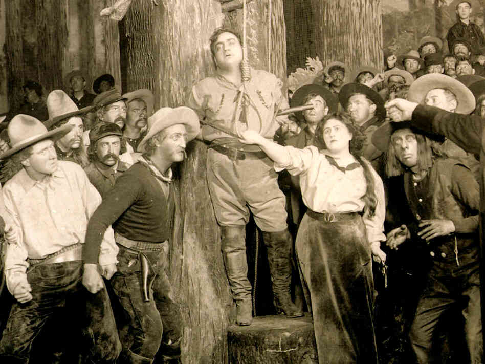 "Enrico Caruso (center) stars in Puccini's ""La Fanciulla del West"""