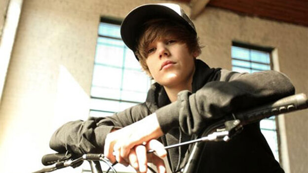 Justin Bieber on a bike