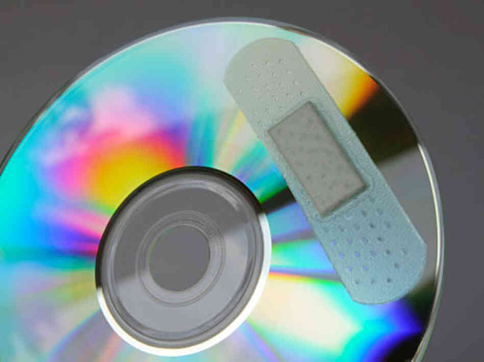 Bandaged CD; credit: CP Cheah / flickr.com