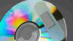 Bandaged CD; credit: CP Cheah / flickr.com