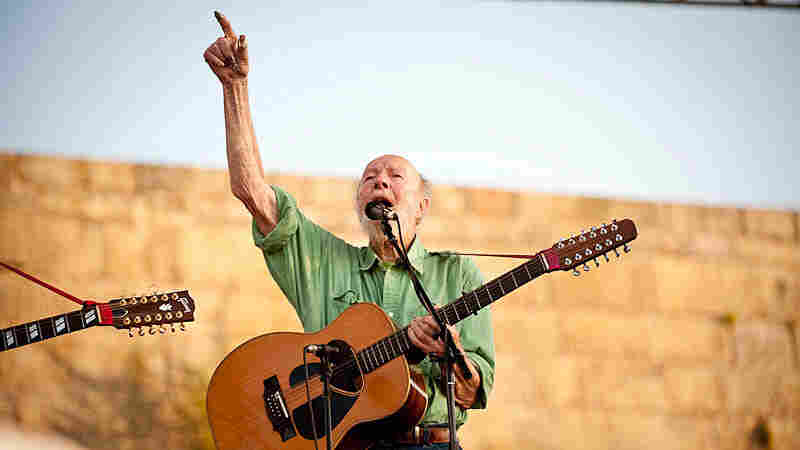 Pete Seeger leads the crowd.