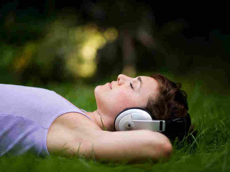 woman in headphones at night