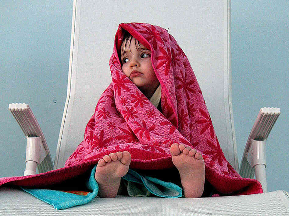 Littel girl in a towel; credit: mitjamavsar / Flickr