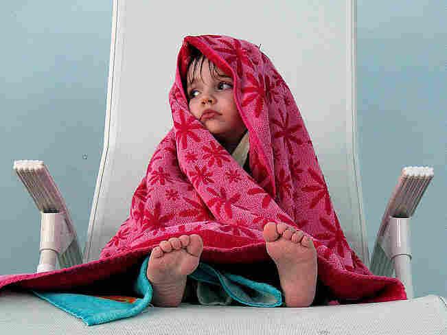 Littel girl in a towel; credit: mitjamavsar / Flickr