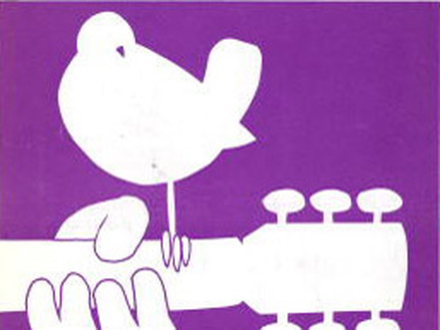 The logo from the Woodstock concert brochure.