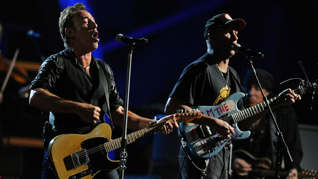 Bruce Springsteen and Tom Morello perform at the Rock and Roll Hall of Fame concert.