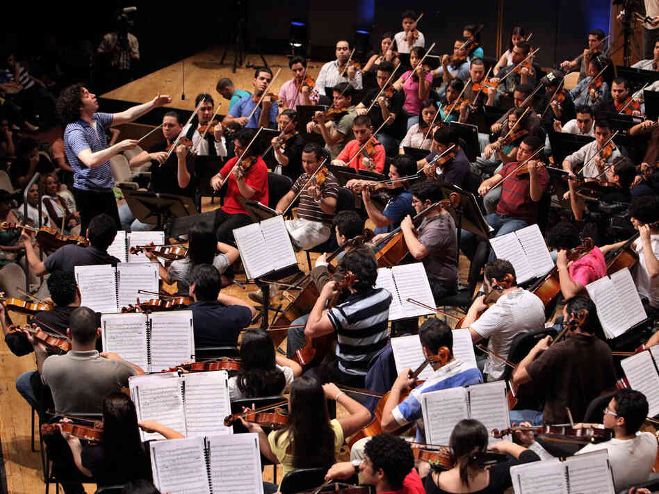 Conductor Gustavo Dudamel leads El Sistema during a June 2009 rehearsal in Caracas, Venezuela.