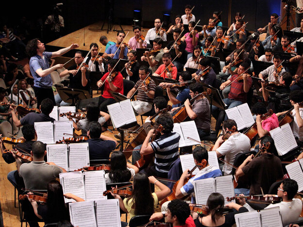 Conductor Gustavo Dudamel leads El Sistema during a June 2009 rehearsal in Caracas, Venezuela.  He is now music director of the Los Angeles Philharmonic. (AFP/ Getty Images)