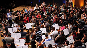 Conductor Gustavo Dudamel conducts El Sistema during a June 2009 rehearsal in Caracas, Venezuela.  He is now music director of the Los Angeles Philharmonic.