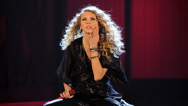 Taylor Swift, seen here performing at the 2009 CMA Awards, cleaned up during the award ceremonies, heralding the arrival of country's next superstar.