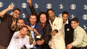 Ozomatli celebrate their win at the Grammys in 2002; credit: Vince Bucci/Getty Images