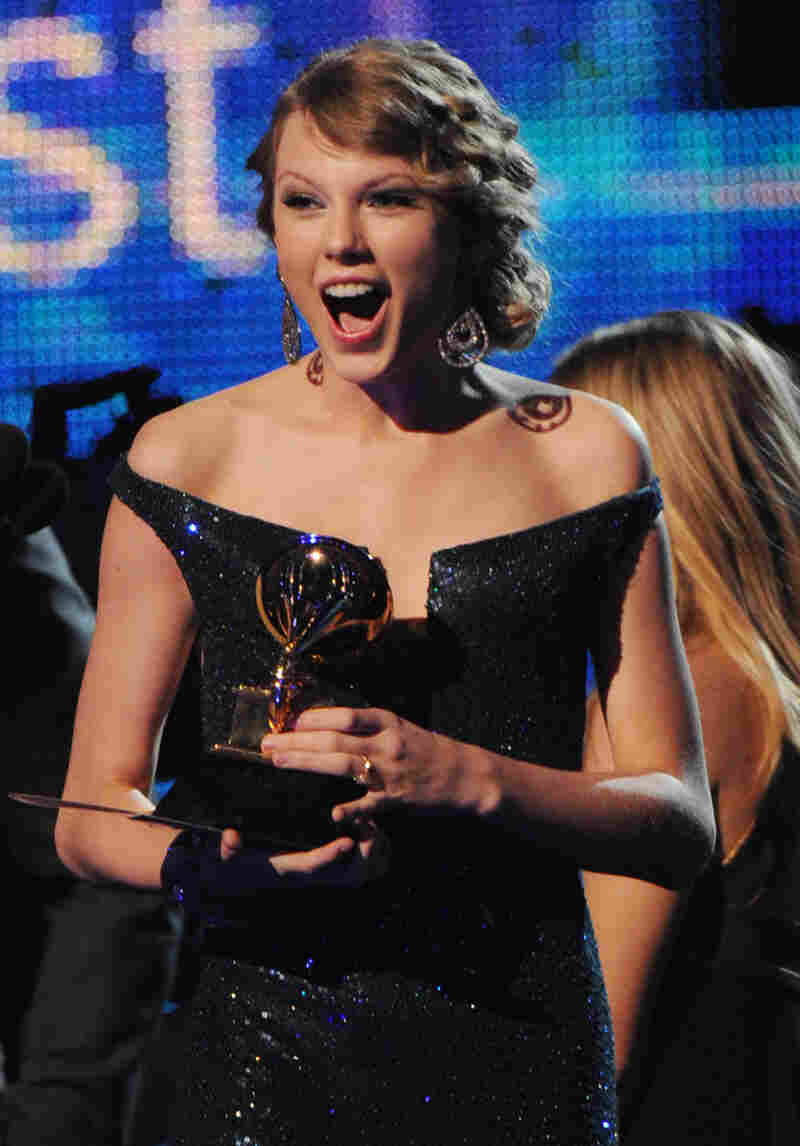 Taylor Swift accepts the album of the year award