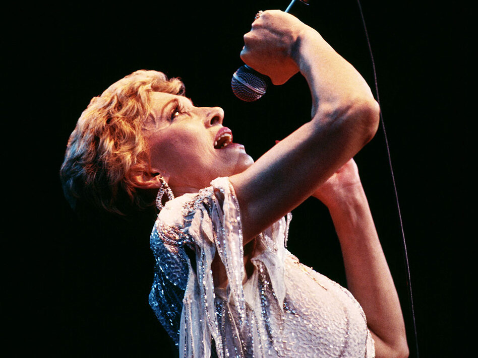 A new biography sees past Tammy Wynette's glittery costumes to examine the singer's deepest struggles.