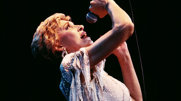 A new biography sees past Tammy Wynette's glittery costumes to examine the singer's deepest struggles. (Getty Images)