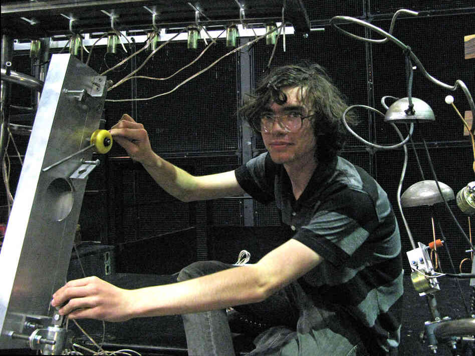 A CalArts student shows off his robot.