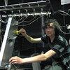 A CalArts student shows off his robot.