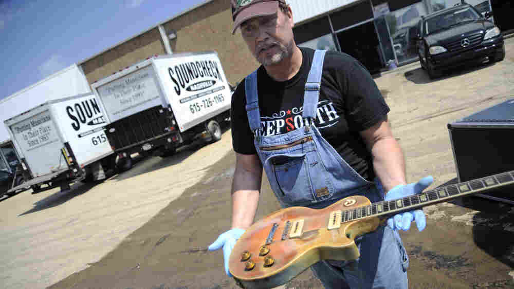 Brent Ware inspects a 1952 Gibson Les Paul that was kept at Soundcheck.
