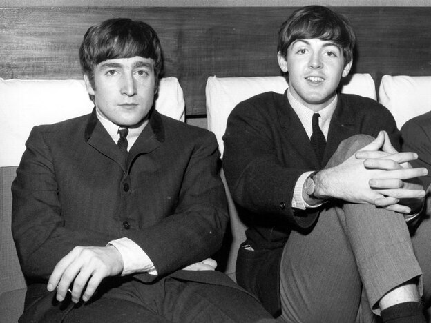 John Lennon (at left) and Paul McCartney in November 1963, just before the release of <em>With the Beatles.</em>