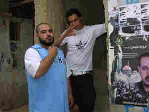 TNT (left) poses with fellow artist MC Tamarrod.