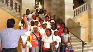 James Harp leads the campers as they sing
