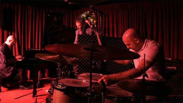 The Bad Plus performing at the Village Vanguard. (John Rogers for NPR/johnrogersnyc.com)