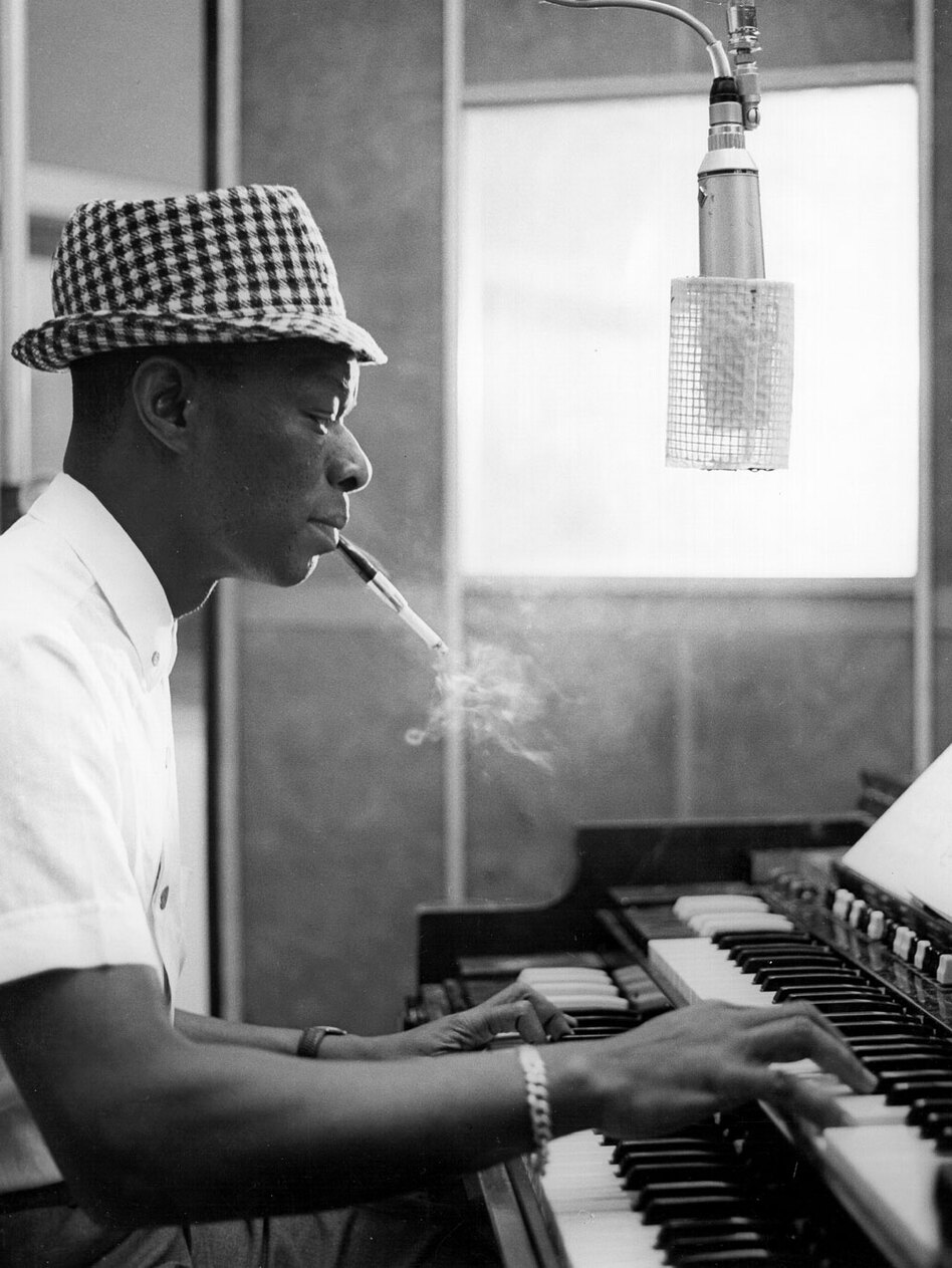 Nat King Cole, circa 1963, records at Capitol Recording Studios in Los Angeles.