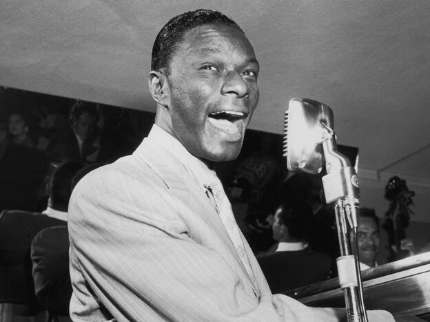 "Nat King Cole at the piano in 1951, the year ""Too Young"" was a huge hit."