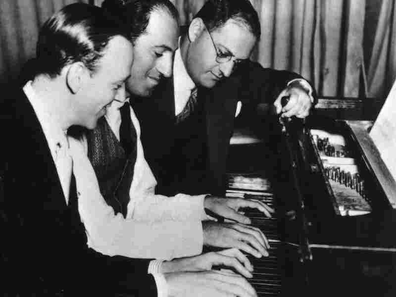George Gershwin (center) with brother Ira (right) and Fred Astaire