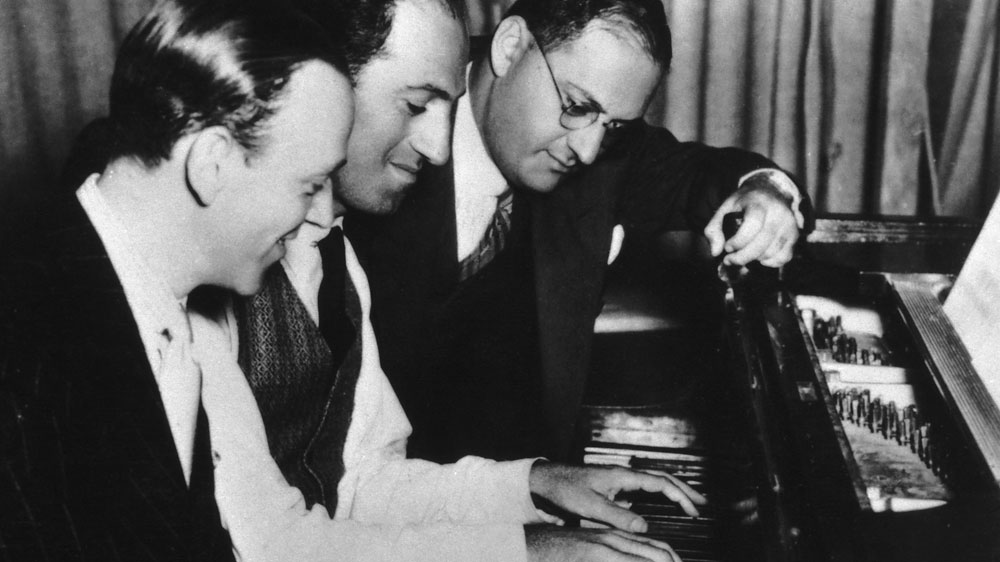 Composer George Gershwin (center) with brother Ira (right) and Fred Astaire