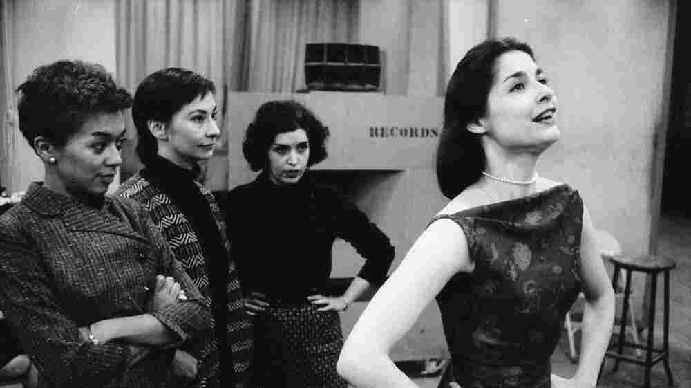 """Carol Lawrence (right) sings """"I Feel Pretty,"""" along with (left to right) Elizabeth Taylor, Carmen Gutierrez and Marilyn Cooper, in the 1957 original Broadway cast recording of West Side Story."""