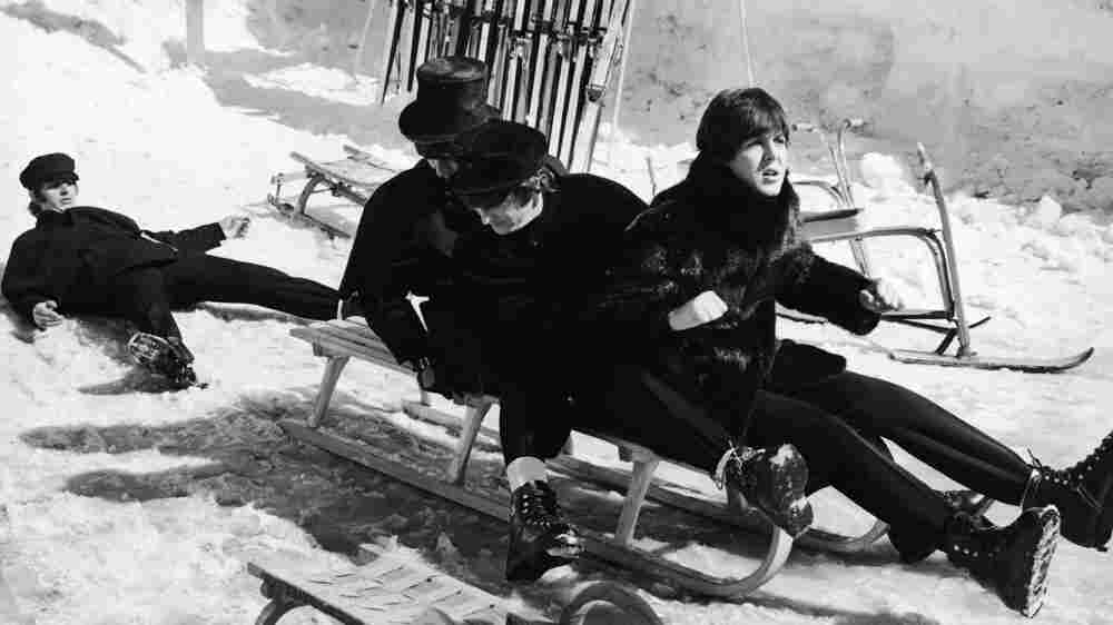 The Beatles on a toboggan in Austria in 1965; credit: Hulton Archive/Getty Images