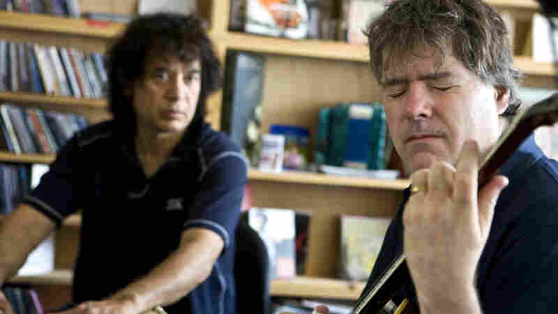 Bela Fleck performs with Zakir Husssain and Edgar Meyer during a Tiny Desk Concert.