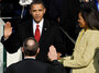 Barack Obama is sworn in as the 44th president of the United States by Supreme Court Chief Justice John Roberts while first lady Michelle Obama looks on.