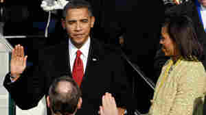 Barack Obama is sworn in as the 44th president by Supreme Court Chief Justice John Roberts.