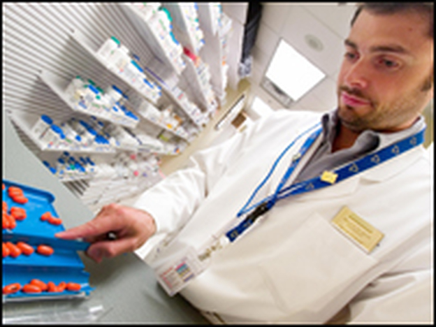 A doctor dispenses drugs at Toronto General Hospital. Canada is one country that has a single-payer health insurance system, which provides universal health care.