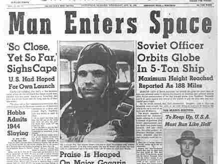 A newspaper announces the first manned space flight.