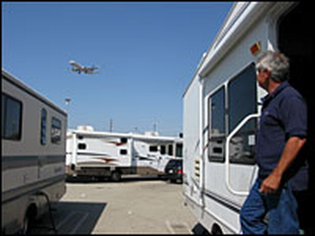 LAX parking lot B is home to airline pilots, flight attendants and crew workers who live in RVs, campers and mobile homes next to one of the busiest runways in the country.