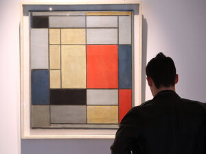 A man looks at 'Composition I' by Piet Mondrian on January 29, 2009, at Christie's in London.