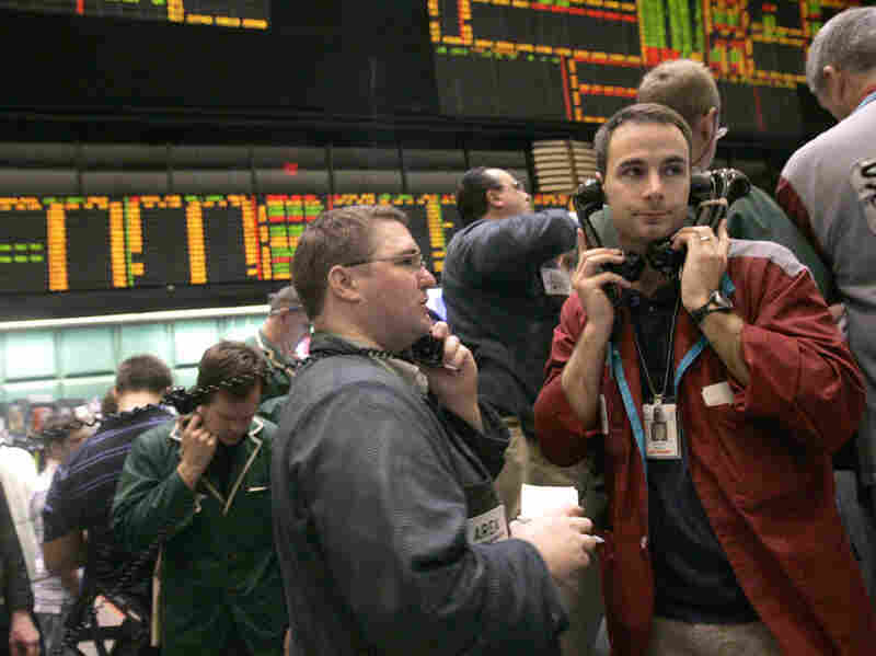 Traders work the crude oil options pit at the New York Mercantile Exchange in June 2008.