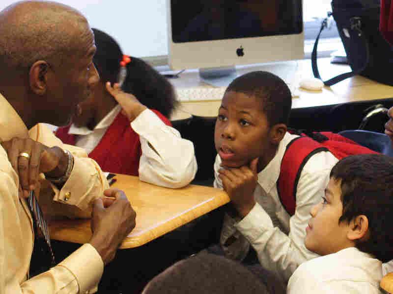Boys listen to Geoffrey Canada