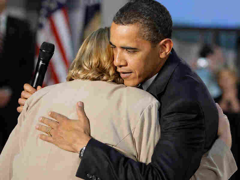 President Obama hugs Virginia Organizing Project volunteer Debby Smith.