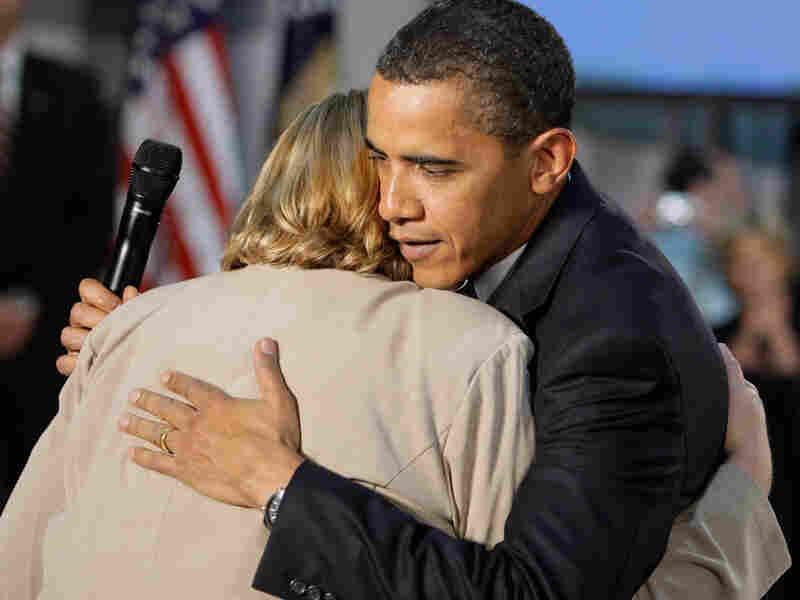 President Obama hugs Virginia Organizing Project volunteer Debby Smith.