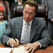 California Gov. Arnold Schwarzenegger signs the state budget on July 28.